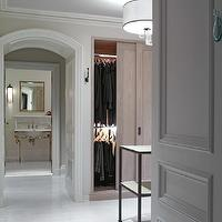 Kathryn Scott Design Studio - bathrooms: walk-in closet, walk in closet design, master bath, master bathroom, arched doorway, curved molding, curved door molding, closet doors, sliding closet doors, gray washed doors, gray washed sliding doors, gray washed closet doors, gray ceiling, gray painted ceiling, closet chandelier, drum chandelier, sparkly drum chandelier, closet island, modern closet island, whitewashed floor, white washed floor, plank floor, white plank floor, white washed plank floor, whitewashed plank floor,