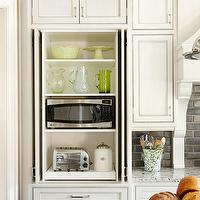 BHG - kitchens - hidden cabinet, hidden appliances cabinet, hidden small appliances cabinet, recessed doors, recessed cabinet doors, sliding cabinet doors, microwave cabinet, sliding appliances drawer, cream cabinets, cream kitchen cabinets, granite countertops, black subway tile, black subway tile backsplash, charcoal gray subway backsplash,