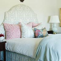 Caitlin Wilson Design - bedrooms - Benjamin Moore - Swan White - arched headboard, upholstered headboard, blue and ivory upholstered headboard, Schumacher Chenonceau in Aquamarine headboard, Schumacher Chenonceau in Aquamarine bed skirt, F Schumacher Chain Link in Cerise pillows, red and white geometric pillows, blue and ivory patterned pillows, Schumacher Chenonceau in Aquamarine pillows, white bedding, white bed linens, folded blue duvet, blue diamond patterned rug, light blue diamond patterned rug, espresso nightstand, light blue gourd lamp, blue gourd lamp, deer mount, white walls, soft white walls, floral pillow, chenonceau fabric, chenonceau fabric headboard, aquamarine chenonceau fabric,