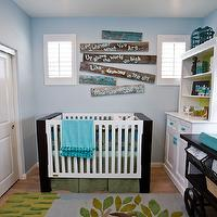 Lulu Designs - nurseries - boy nursery, boys nursery, baby boy nursery, baby boys nursery, boy nursery design, boys nursery design, blue walls, blue nursery walls, plank wood art, painted plank boards, two tone crib, modern crib, modern two tone crib, turquoise blue throw, turquoise throw, fringed throw, bird cage, turquoise bird cage, turquoise blue bird cage, turquoise accents, turquoise blue accents, white bookshelf, nursery bookshelf, lined bookshelf, wallpapered bookshelf, roman shade, boys window treatments, nursery window treatments, plaid roman shade, yellow and blue roman shade, boys cribs, boys nursery art, vintage changing table, industrial changing table, repurposed changing table, blue accents, turquoise nursery accents, blue and yellow nursery, blue and yellow rug,