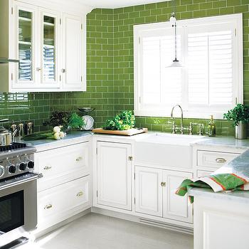 Style at Home - kitchens - white and green kitchen, green subway tile, green backsplash, green kitchen backsplash, green subway tile backsplash, green subway backsplash, white cabinets, carrara marble, carrara marble countertops, farmhouse sink, barn pendant, barn pendant light, vintage barn pendant, green leafy accents, stainless steel range, bridge faucet, bridge kitchen faucet,