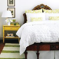 Style at Home - bedrooms: eclectic bedroom, french headboard, french bed, carved wood bed, white ebdding, crips white bedding, pintuck duvet, pintuck bedding, pelagos pillows, yellow pelagos pillows, windsor smith fabric, bed skirt, pleated bed skirt, rug under bed, white and green rug, striped rug, white and green striped rug, bamboo nightstand, yellow bamboo nightstand, faux bamboo nightstand, yellow faux bamboo nightstand, marble top nightstand,