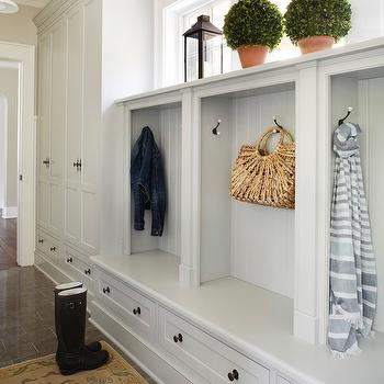 Molly Quinn Design - laundry/mud rooms - built-in mudroom cabinetry, built-in mudroom cupboards, mudroom bench, mudroom storage bench, built-in storage bench, cubbies, built-in cubbies, mudroom cubbies, mudroom storage, tiled mudroom, tiled mudroom floors, oushak rug, antique oushak rug, tiled floors, custom cabinetry, custom mudroom cabinetry, tongue and groove paneling, topiaries, boxwood topiaries, lantern, lantern candle holder, mud room, mud room lockers,