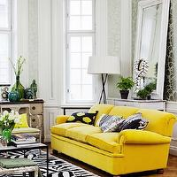 Skonahem - living rooms - herringbone parquet floors, yellow velvet couch, christian lacroix zebra print rug, yellow velvet sofa, black and white pillow, black and yellow throw pillow, black and white zebra print rug, zebra print rug, black coffee table, stacked books, emerald green vase, distressed white stool, french style dresser, blue glass bottles, green glass bottles, antique danish chair, contemporary floor lamp, leaning white mirror, silver and sage damask style wallpaper, contemporary pendant, bright yellow sofa, retro sofa, vintage yellow sofa, wood floors, hardwood floors, hardwood herringbone floors, french chair, leaning wall mirror, metallic damask wallpaper, silver and green metallic wallpaper, yellow sofa, yellow couch,