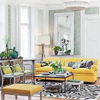 Skonahem - living rooms - parquet floors, yellow ottoman, leopard print stool, herringbone parquet floors, yellow velvet couch, christian lacroix zebra print rug, yellow velvet sofa, black and white pillow, black and yellow throw pillow, black and white zebra print rug, zebra print rug, black coffee table, stacked books, emerald green vase, distressed white stool, french style dresser, blue glass bottles, green glass bottles, antique danish chair, contemporary floor lamp, leaning white mirror, silver and sage damask style wallpaper, contemporary pendant, bright yellow sofa, retro sofa, vintage yellow sofa, wood floors, yellow sofa, yellow couch, hardwood floors, hardwood herringbone floors, french chair, leaning wall mirror, metallic damask wallpaper, silver and green metallic wallpaper,