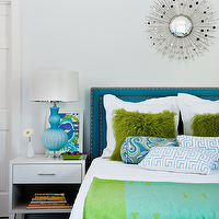 Manny Rodriguez Photography - girl's rooms - turquoise headboard, hermes throw blanket, turquoise silk headboard, turquoise headboard with nailhead trim, silver sunburst mirror, sunburst mirror, white bedding, white pillows, white coverlet, fluffy green pillows, green wool pillows, blue and white greek key pillows, bolster pillow, blue bolster pillow, blue and green bedroom, blue and green hermes throw blanket, white nightstand, white single drawer nightstand, white contemporary nightstand, turquoise blue lamp, ribbed glass lamp, framed art, stacked books, hardwood floors, dark hardwood floors, white walls, blue and green girls bedroom, blue and green girls room, turquoise rug,