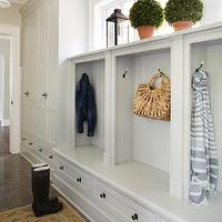 Molly Quinn Design - laundry/mud rooms - Farrow & Ball - Shaded White - built-in mudroom cabinetry, built-in mudroom cupboards, mudroom bench, mudroom storage bench, built-in storage bench, cubbies, built-in cubbies, mudroom cubbies, mudroom storage, tiled mudroom, tiled mudroom floors, oushak rug, antique oushak rug, tiled floors, custom cabinetry, custom mudroom cabinetry, tongue and groove paneling, topiaries, boxwood topiaries, lantern, lantern candle holder, mud room, mud room lockers,