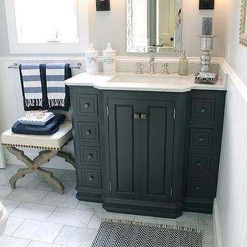 Classic Casual Home - bathrooms - gray walls, gray bathroom walls, venetian mirror, bathroom venetian mirror, venetian bathroom mirror, oil rubbed bronze sconces, black vanity, bathroom vanity, bathroom, black cabinet, black bathroom cabinet, marble countertops, french apothecary jars, chevron bath mat, bath mat, black and white bath mat, black and white chevron bath mat, bathroom ottoman, cream ottoman, gray ottoman, nailhead ottoman, turkish towels, turkish hand towels,