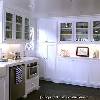 Classic Casual Home - kitchens - kitchen cabinets, shaker cabinets, white shaker cabinets, marble countertops, beadboard, kitchen beadboard, beadboard backsplash, white beadboard backsplash, glass front cabinets, glass front kitchen cabinets, upper cabinets, shaker cabinets, shaker lower cabinets, lower cabinets, lower kitchen cabinets, farmhouse sink, stainless steel dishwasher, dishwasher, microwave nook, built in microwave nook, dutch door, kitchen dutch door, charcoal gray tile, slate tile, charcoal gray slate tile, charcoal gray slate floor, pull out microwave,