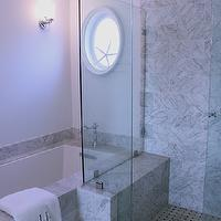 Classic Casual Home - bathrooms - master bath, master bathroom, marble basketweave floor, marble basketweave tile floor, black and white marble floor, black and white marble tile floor, drop in tub, marble drop in tub, marble tub surround, porthole mirror, oval porthole mirror, glass shower, seamless glass shower, marble tile, marble tile bathroom, marble tile bathroom, marble shower bench, shower bench, shower design, marble shower floor, marble basketweave shower floor,