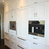 Sarah Gallop Design - kitchens - wall of kitchen cabinets, built-in fridge, built-in refrigerator, concealed fridge, concealed refrigerator, paneled fridge, paneled refrigerator, paneled refrigerator drawers, hidden refrigerator, brushed nickel hardware, white kitchen cabinets, white kitchen cabinetry, white recessed panel kitchen cabinets, white cabinets, white cabinetry, built-in microwave, stainless steel microwave, built-in coffee maker, built-in coffee station, coffee station, miele coffee station, recessed lighting, pot lights, crown molding, ceiling height cabinetry, hardwood floors, custom kitchen, custom kitchen cabinets, hidden fridge, concealed refrigerator,
