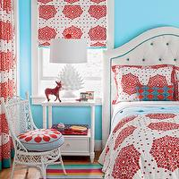 Coastal Living - girl's rooms - bright turquoise walls, turquoise wall color, bold turquoise walls, bright blue walls, blue walls, blue wall color, hardwood floors, multi-colored rug, multi-colored striped rug, red and white girls bedding, red and white drapes, red and white patterned drapes, headboard with contrasting button tufting, headboard with contrasting piping, bold red and white patterned drapes, vintage wicker chair, wicker chair, white wicker chair, blue and red seat cushion, turquoise coverlet, off-white upholstered headboard, upholstered button tufted headboard, diamond button tufted headboard, headboard with turquoise piping, white nightstand, spiky white lamp, modern white table lamp, red and white window blinds, red and turquoise girls bedroom, red and turquoise girls room, brightly colored girls bedroom, artichoke Lamp, Stray Dog Designs lamps, blue and red girls room, blue and red girls bedroom, bamboo nightstand, white bamboo nightstand, Stray Dog Design White Artichoke Lamp,