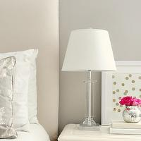 Brunch at Saks - bedrooms: gray walls, gray wall color, gray bedroom, gray bedroom walls, nightstand vignette, crystal table lamp, polka dot art, framed polka dot art, stacked books, mercury glass bowl, mercury glass vase, pink roses, hot pink roses, leaning art, upholstered headboard, off-white upholstered headboard, white bedding, white bed linens, gray pillow, ivory nightstand, ivory colored nightstand, amazing gray, greige walls, greige paint color,
