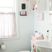 A Sort of Fairytale - bathrooms - Martha Stewart - Cumulus Cloud - vintage accessories, vintage bathroom accessories, vintage bath accessories, watery blue walls, watery blue paint, watery blue paint color, light blue walls, light blue bathroom walls, light blue paint, light blue paint colors, cafe curtain, striped cafe curtain, bathroom cafe curtains, cafe window treatments, pedestal sink, frameless mirror, whitewashed crate, vintage crate, vintage whitewashed crate, bathroom paint colors, blue bathroom paint colors, cumulous cloud,