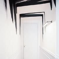 Lonny Magazine - entrances/foyers - brushstroke ceiling, black brushstroke ceiling, abstract ceiling, black brushstroke painted ceiling, white walls, wood paneled walls, wall paneling, hallway, contemporary lighting, modern brushstroke ceiling, black and white hallway, black and white entryway, brushstroke walls, brushstroke painted walls,