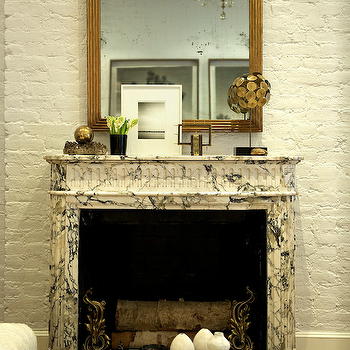 Matchbook Magazine - living rooms - brick wall, exposed brick wall, white brick wall, white exposed brick wall, marble fireplace, gold mirror, fireplace mirror, gold fireplace mirror, brass accents, fireplace accents, brass fireplace accents,