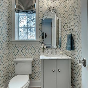 Great Neighborhood Homes - bathrooms - powder room, chic powder room, moroccan wallpaper, moroccan tile wallpaper, moorish tile wallpaper, quatrefoil wallpaper, blue and gray quatrefoil wallpaper, blue and gray wallpaper, crown molding, powder room crown molding, wood floors, powder room wood floors, powder room roman shade, powder room window treatments, half bath, chic half bath, half bath design, half bath wallpaper, powder room wallpaper, half bath window treatments, roman shade, gray roman shade, greek key, greek key trim, greek key roman shade, roman shade with greek key trim, arch mirror, arched mirror, frameless arched mirror, frameless arch mirror, allen + roth mirrors, hovan arch mirror, gray vanity, gray bathroom vanity, scalloped vanity, scalloped bathroom vanity, gray scalloped vanity, gray scalloped bathroom vanity, marble countertops, gray vanity with marble countertop, gray bathroom vanity with marble countertop, gray cabinet, gray bathroom cabinet, gray cabinet with marble countertop, gray bathroom cabinet with marble countertop, crystal chandelier, powder room crystal chandelier, wood floors, powder room wood floor, half bath chandeliers, Allen + Roth Hovan Arch Frameless Mirror,