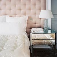 Lonny Magazine - bedrooms - pink and gray bedroom, pink headboard, tufted pink headboard, dramatic tufted pink headboard, dramatic headboards, hardwood floors, traditional style rug, gray acanthus leaf rug, wall molding, paneled walls, gray walls, blue gray walls, white bedding, white bed linens, white duvet, white pillows, ivory duvet, mirrored nightstand, crystal lamps, crystal column lamp, french bedroom, glamorous bedroom, feminine bedroom, pink tufted headboard, mirror nightstand, mirrored nightstand,