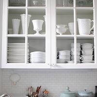 Grace Happens - kitchens - glass font cabinets, glass front kitchen cabinets, milk glass pitcher, milk glass vase, milk glass bowls, milk glass serveware, white cabinets, white kitchen cabinets, iridescent tile, iridescent tile backsplash, oceanside tiles, iridescent backsplash, iridescent kitchen backsplash, honed marble, honed marble counters, honed marble countertops,