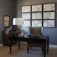 Alice Lane Home - dens/libraries/offices - home office, wall to wall carpet, natural fiber carpet, dark gray walls, dark gray walls color, glossy black desk, black desk, wing style desk chair, wing chair with geometric upholstery, vintage framed map, segmented wall map, map of america, map of the usa, map of the united states, framed map of the united states, vintage framed map of america, sculptural table lamp, marble objects, marble ornaments, bar area, industrial wood and metal chest, industrial chest, framed print, bar tray, bar tray with glasses, ice bucket, masculine office,