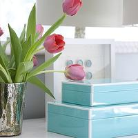 Shelter Interior Design - living rooms - vignette, tabletop vignette, blue gray walls, blue gray wall color, pink tulips, mercury glass vase, white wall mirror, turquoise boxes, lacquered turquoise boxes, shadowbox, seashell shadowbox, Tortoise Table Lamp, , Arteriors Tortoise Table Lamp,