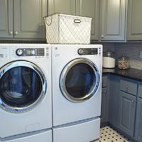 Fabulous laundry room with white front loading washer and dryer and painted gray green ...