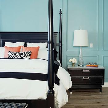 bedrooms - turquoise and black bedroom, turquoise blue and black bedroom, turquoise walls, turquoise wall moldings, turquoise blue walls, turquoise blue wall moldings, four poster bed, black bed, black poster bed, black four poster bed, orange pillows, zebra pillow, lumbar pillow, zebra lumbar pillow, black and white bedding, border bedding, frame bedding, border duvet, black and white border bedding, black and white frame bedding, black and white border duvet, bedroom bench, bed bench, bench at foot of bed, black bench, tufted bench, patent leather bench, black tufted bench, black patent leather bench, black leather tufted bench, black nightstand, marble top nightstand,