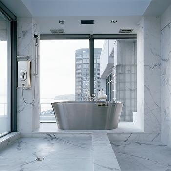 Toth Construction - bathrooms - city bathroom, high rise bathroom, sleek city bathroom, sleek high rise bathroom, high rise bathroom, modern bathroom, modern high rise bathroom, modern sleek bathroom, modern marble bathroom, marble bathroom, floor to ceiling windows, frosted glass shower, frosted glass shower door, metal tub, modern tub, modern bathtub, modern metal tub, tub in front of window, high rise bathroom,