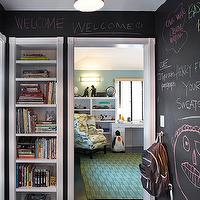 Tim Barber - boy&#039;s rooms - chalkboard walls, chalk paint walls, chalk board painted walls, hardwood floors, dark hardwood floors, built-in bookshelves, recessed built-in bookshelves, bookshelves in hallway, teal blue walls, teal and green geometric rug, geometric rug, kids room, upholstered wing chair, built-in desk, playroom chalkboard walls, play room chalkboard walls,