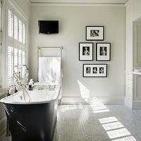 Toth Construction - bathrooms - master bath, master bathroom, chic bathroom, chic master bath, chic master bathroom, cast iron tub, tub in front of window, floor mount tub filler, tub filler, floor mounted tub filler, bath caddy, bathroom windows, plantation shutters, bathroom plantation shutters, plantation shutters bathroom, white carrara marble hex tiles, white carrara marble hex tile floor, white carrara hex tile bathroom, white carrara marble hex floor, floor to ceiling cabinets, floor to ceiling bathroom cabinets, vertical cabinets, vertical bathroom cabinets, built in vanity, built in bathroom vanity, floating sink, marble floating sink, floating marble sink, floating vanity, floating marble vanity, marble vanity, bathroom tv, towel warmer, wall mount towel warmer, wall mounted towel warmer, bathroom photo wall, photo wall bathroom, black gallery frames, black and white photo wall, black and white photo gallery, bathroom photo gallery, photo gallery bathroom, gray walls, bathroom gray walls, floating sink vanity,