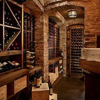 Toth Construction - basements - basement wine cellar, wine cellar, exposed brick wall, arched brick alcoves, brick alcoves, arched alcoves, alcoves, wine cellar alcove, buil tin wine racks, basement wine racks, wine cellar wine racks, hex flush mount, wine cellar lighting,