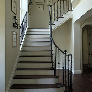Andrew Howard Interior Design - entrances/foyers - traditional staircase, staircase, iron handrail, handrail, banister, iron banister, iron railing, iron staircase railing, staircase railing, spindles, iron spindles, staircase spindles, iron staircase spindles, photo walls, staircase photo wall, staircase landing, staircase landing photo wall,