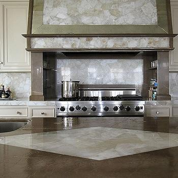 Andrew Howard Interior Design - kitchens - onyx counters, onyx countertops, onyx backsplash, onyx slab backsplash, cream cabinets, cream kitchen cabinets, kitchen hood, inlaid kitchen hood, onyx kitchen hood, spice racks, cooktop spice racks, buil tin spice racks, 8 burner gas range, kitchen island, prep sink, gooseneck faucet, kitchen island sink, inlaid kitchen island, inlay kitchen island, inlaid kitchen island countertop, inlay kitchen island countertop,