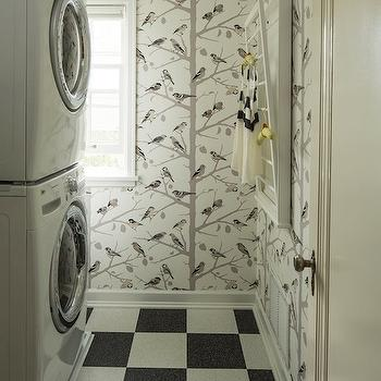 Lucy Interior Design - laundry/mud rooms - bird wallpaper, contemporary bird wallpaper, birds and branches wallpaper, front loading washer, white front loading washer, front loading dryer, white front loading dryer, stackable washer and dryer, wallpapered laundry room, wall mounted drying rack, drying rack, laundry room drying rack, black and white checkerboard floors, checkerboard floors, black and white tiled floors, a-twitter wallpaper, A-Twitter Winter Wallpaper,