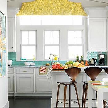 House Beautiful - kitchens - turquoise and yellow kitchen, turquoise blue and yellow kitchen, blue and yellow kitchen, kitchen with yellow accents, kitchen with turquoise accents, kitchen with blue accents, vaulted ceiling, kitchen vaulted ceiling, vaulted ceiling kitchen, kitchen cornice box, cornice box kitchen, yellow cornice box, geometric cornice box, turquoise tile, turquoise blue tile, turquoise tile backsplash, turquoise blue tile backsplash, turquoise kitchen backsplash, turquoise blue kitchen backsplash, turquoise tile kitchen, marble island, marble kitchen island, cherner stools, cherner counter stools, white cabinets with dark wood floors, white cabinets with dark hardwood floors, white kitchen cabinets with dark wood floors, white kitchen cabinets with dark hardwood floors, , Cherner Barstool,