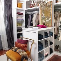 Meredith McBride Kipp - closets - walk in closet, closet design, walk in closet design, closet system, closet cabinets, white closet cabinets, sweater shelves, sweater cubbies, bag shelves, purse shelves, closet island, closet chandelier, jean cubbies, pants cubbies, mirrored top closet island, built-in cubbies, closet jean storage, closet pants storage, white sheers, purple sheers, gray purple sheers, velvet chair, closet chair, pumpkin orange chair, pumpkin orange velvet chair, orange chair, velvet orange chair, orange velvet chair, chevron throw, chevron throw blanket, burnt orange, burnt orange pillow, geometric pillow, burnt orange lumbar pillow, burnt orange velvet pillow, fuchsia pillow, slipper chair, billy haines chair, billy haines slipper chair, gold chair,