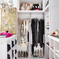 Meredith McBride Kipp - closets - walk in closet, closet design, walk in closet design, closet system, closet cabinets, white closet cabinets, shelves for shoes, shoe shelves, bag shelves, purse shelves, closet island, closet chandelier, jean cubbies, pants cubbies, mirrored top closet island, built-in cubbies, closet jean storage, closet pants storage, clothes arranged by hues, clothes arranged by color,
