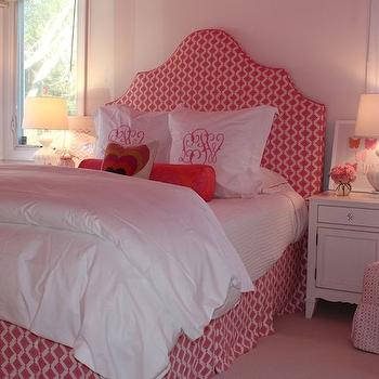 Julie Rootes Interiors - girl's rooms - pink walls, pink wall color, girls bedroom, pink girls bedroom, upholstered headboard, arched headboard, pink headboard, pink and white headboard, pleated bed skirt, matching bed skirt, white bedding, white bed linens, white euro sham, monogrammed pillow, monogrammed euro sham, pink bolster pillow, heart pillow, heart print pillow, white nightstand, white glass lamp, rippled white lamp, pink flowers, leaning art, pink butterfly art, pink and white geometric print headboard, pink and white geometric print bed skirt, armless slipper chair, pink slipper chair, mongolian wool pillow, fluffy white pillow, White Glass Ripple Lamp, , Regina Andrew White Rippled Glass Table Lamp,