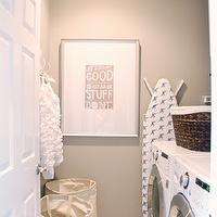 McGee Life - laundry/mud rooms - laundry room, laundry room design, white and gray laundry room, gray laundry room walls, white crown molding, hampers, canvas hampers, front load washer and dryer, white washer and dryer, ironing board, laundry room ironing board, white and blue ironing board,