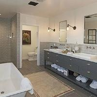 Kishani Perera - bathrooms - water closet, gray bath, gray bathroom, gray master bath, gray master bathroom, master bath, master bathroom, gray subway tile, gray subway tile walls, gray subway tiled wall, gray subway backsplash, gray subway tile bathroom, gray subway tile bathroom, freestanding tub, modern freestanding tub, modern bathtub, slate tile, slate floor, slate tile floor, slate tile bathroom floor, gray double vanity, gray double washstand, gray cabinets, gray console, gray bathroom console, gray double console, gray bathroom console, gray bathroom cabinets, marble countertops, gray vanity with marble countertops, gray cabinets with marble countertops, gray vanity with white marble countertops, gray cabinets with white marble countertops, gray washstand with marble countertop, gray washstand with white marble countertop, his and her sinks, inset medicine cabinets, medicine cabinets, wall mount faucet, wall mounted faucet, bronze sconces, swing arm sconces, bronze swing arm sconce,