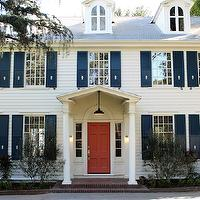 Kishani Perera - home exteriors - Benjamin Moore - Golden Gate - colonial home, navy blue shutters, in the midnight hour, shutters, front foor, painted front foor, coral front door,