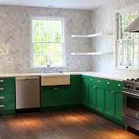 Kishani Perera - kitchens - Benjamin Moore - Once Upon a Time - emerald green, emerald green cabinets, emerald green kitchen cabinets, green cabinets, green kitchen cabinets, quartz countertops, white quartz counters, white quartz countertops, marble herringbone tile, marble herringbone tile backsplash, marble herringbone backsplash, marble herringbone backsplash tile, marble herringbone kitchen tile, marble herringbone kitchen backsplash, marble herringbone kitchen backsplash tile, corner shelves, floating shelves, floating corner shelf, apron sink, ribbed apron sink, stainless steel kitchen hood, stainless steel range, emerald green paint, emerald green paint colors, painted cabinets, painted kitchen cabinets, herringbone tile, herringbone backsplash,
