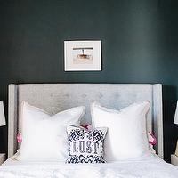 The Every Girl - bedrooms - pink and gray bedroom, black walls, black bedroom walls, black paint, black paint colors, gray wingback headboard, gray headboard, linen headboard, gray linen headboard, studded headboard, gray studded headboard, gray nailhead headboard, ventura duvet, embroidered sheets, embroidered sheet set, shams, berry shams, pink shams, border frame shams, pink shams, pink border frame shams, mid century nightstands, white nightstands, pink lamp, pink gourd lamp, pink table lamp, pink ceramic lamp, robert abbey lamp, gourd lamp, pink gourd lamp, triple gourd lamp, pink triple gourd lamp, lust pillow, jonathan adler pillows, Skyline Furniture Wingback Bed in Linen Gray, Serena and Lily Berry Border Frame Sham, Serena and Lily Ventura Duvet, Jonathan Adler Victorian Lust Pillow, West Elm Mid Century Nightstand, Robert Abbey Pink Triple Gourd Ceramic Table Lamp, Jayson Home Mercury Bottle,