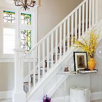 Style at Home - entrances/foyers: foyer, craftmans style, traditional staircase, bronze chandelier, foyer chandelier, acrylic table, foyer table, acrylic console table, tufted ottoman, cream ottoman, cream tufted ottoman, round tray, mustard yellow vase,