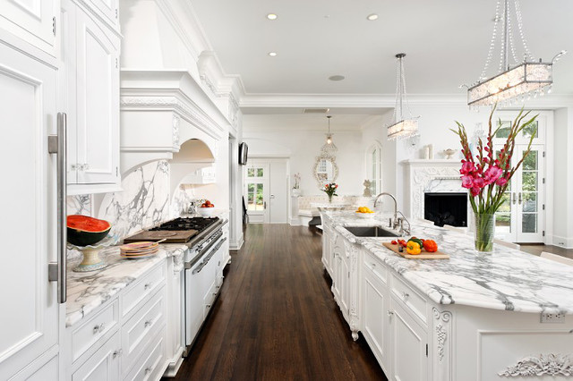 Bradford Designs - kitchens - white kitchen, traditional kitchen, traditional white kitchen, white kitchen cabinets, white kitchen cabinetry, marble counters, marble countertops, calacatta ora marble, calacatta ora marble counters, calacatta marble countertops, french doors, transom windows, ornate fireplace, white fireplace, fireplace, undermount sink, stainless steel undermount sink, gooseneck faucet, crystal knobs, crystal hardware, french blue chairs, recessed lighting, pot lights, crystal pendants, crown molding, kitchen island, traditional kitchen island, kitchen island sink, sink in kitchen island, french style kitchen, white french style kitchen, dark hardwood floors, hardwood floors, white oven, formal kitchen, formal white kitchen, white on white kitchen, all white kitchen,