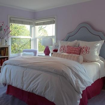 Julie Rootes Interiors - girl's rooms - purple girls room, purple rug, lavender walls, lavender wall color, lavender colored rug, white nightstands, modern white nightstands, leaning art, hot pink lamps, hot pink bed skirt, upholstered headboard, bed skirt, white bedding, white duvet, white bed lines, euro shams, monogrammed euro shams, monogrammed pillows, pink pillow, bolster pillow, low bookshelf, books arranged by color, books organized by color, white coverlet, white folded duvet, pink lattice pillow, striped bolster pillow, bookshelf, plant, branches, faceted pink lamp, Robert Abbey Delta Schiaparelli Pink High Table Lamp, Bungalow 5 Jacqui 3-Drawer Side Table, blue and pink girls room, blue and pink girls bedroom, blue girls headboard, blue headboard, Delta Schiaparelli Pink High Table Lamp, Bungalow 5 Jacqui 3-Drawer Side,