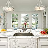 Bradford Designs - kitchens - white kitchen, traditional kitchen, traditional white kitchen, white kitchen cabinets, white kitchen cabinetry, marble counters, marble countertops, calacatta ora marble, calacatta ora marble counters, calacatta marble countertops, breakfast area, interior french doors, transom windows, ornate fireplace, white fireplace, fireplace in breakfast area, undermount sink, stainless steel undermount sink, gooseneck faucet, crystal knobs, crystal hardware, french blue chairs, recessed lighting, pot lights, crystal pendants, crown molding, kitchen island, traditional kitchen island, kitchen island sink, sink in kitchen island, french style kitchen, white french style kitchen, formal kitchen, formal white kitchen, white on white kitchen, all white kitchen,