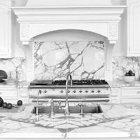 Bradford Designs - kitchens - formal kitchen, formal white kitchen, white on white kitchen, all white kitchen, white kitchen, traditional kitchen, traditional white kitchen, white kitchen cabinets, white kitchen cabinetry, marble counters, marble countertops, calacatta marble, calacatta marble counters, calacatta marble countertops, crystal knobs, crystal hardware, french style kitchen, white french style kitchen, oven hood, custom hood, paneled hood, hood with corbel supports, seamless backsplash, marble backsplash, calacatta marble backsplash, ceiling height cabinets, white oven, white range, white oven range, custom oven hood, grand oven hood, large white oven hood, kitchen island, kitchen island sink, formal kitchen island, undermount sink, undermount stainless steel sink, gooseneck faucet,