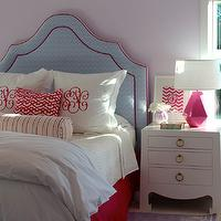 Julie Rootes Interiors - girl's rooms: purple girls room, lavender walls, lavender wall color, white nightstands, modern white nightstands, leaning art, hot pink lamps, hot pink bed skirt, upholstered headboard, bed skirt, white bedding, white duvet, white bed lines, euro shams, white coverlet, white folded duvet, pink lattice pillow, striped bolster pillow, monogrammed euro shams, chevron art, leaning art on nightstand, monogrammed pillows, pink pillow, bolster pillow, blue chevron print headboard, blue headboard with pink piping, , faceted pink lamp, Delta Schiaparelli Pink High Table Lamp, Jacqui 3-Drawer Side Table, blue headboard, chevron headboard, blue chevron headboard,