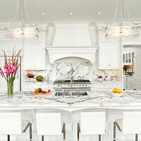 Bradford Designs - kitchens - white kitchen, traditional kitchen, traditional white kitchen, white kitchen cabinets, white kitchen cabinetry, marble counters, marble countertops, calacatta marble, calacatta marble counters, calacatta marble countertops, undermount sink, stainless steel undermount sink, gooseneck faucet, crystal knobs, crystal hardware, recessed lighting, pot lights, crystal pendants, crown molding, kitchen island, traditional kitchen island, kitchen island sink, sink in kitchen island, french style kitchen, white french style kitchen, modern barstools, white leather barstools, white leather and chrome barstools, modern white leather and chrome barstools, transom window, concealed fridge, cabinet fronted fridge, cabinet fronted refrigerator, oven hood, custom hood, paneled hood, hood with corbel supports, hardwood floors, dark hardwood floors, kitchen tv, flat screen tv in kitchen, wall mounted tv, seamless backsplash, marble backsplash, calacatta marble backsplash, ceiling height cabinets, formal kitchen, formal white kitchen, white on white kitchen, all white kitchen,